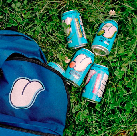 Blue, Grass, Footwear, Turquoise, Shoe, Beverage can, Hand, Plant, Aluminum can, Glasses,