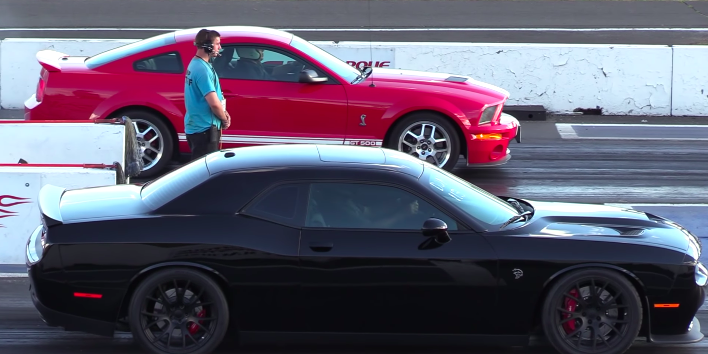 Watch this decade old shelby mustang smoke a hellcat on the strip