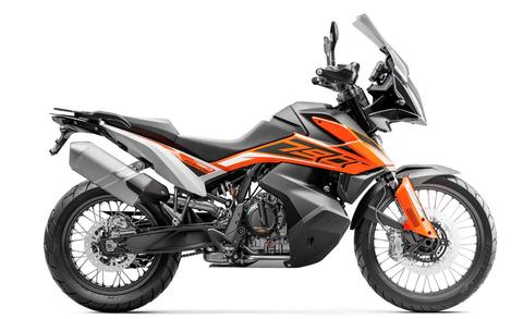 Land vehicle, Motorcycle, Vehicle, Automotive exhaust, Motor vehicle, Car, Orange, Supermoto, Fuel tank, Spoke,