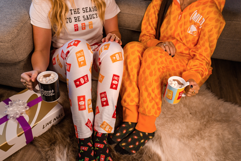37413a3d73c Taco Bell s Holiday Collection Includes Hot Sauce Onesies - Taco ...