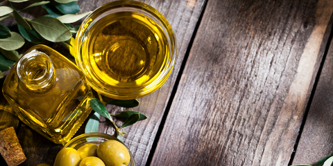 Olive, Extra virgin olive oil, Yellow, Fruit, Cooking oil, Liqueur, Food, Olive oil, Plant, Drink,