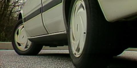 Land vehicle, Vehicle, Car, Tire, Wheel, Automotive tire, Motor vehicle, Alloy wheel, Vehicle door, Automotive design,