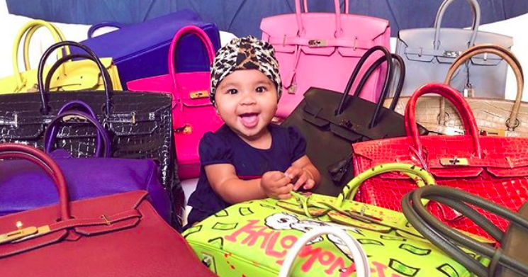 Baby True Surrounded By Birkin Bags