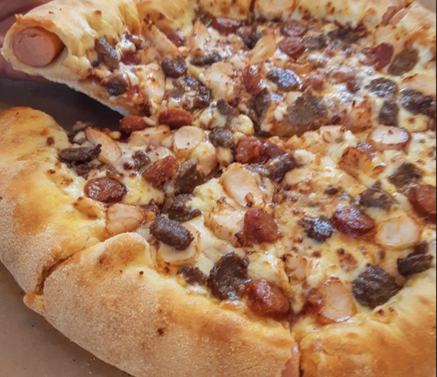 Domino S Is Stuffing Its Crust And Topping Pizzas With Hot