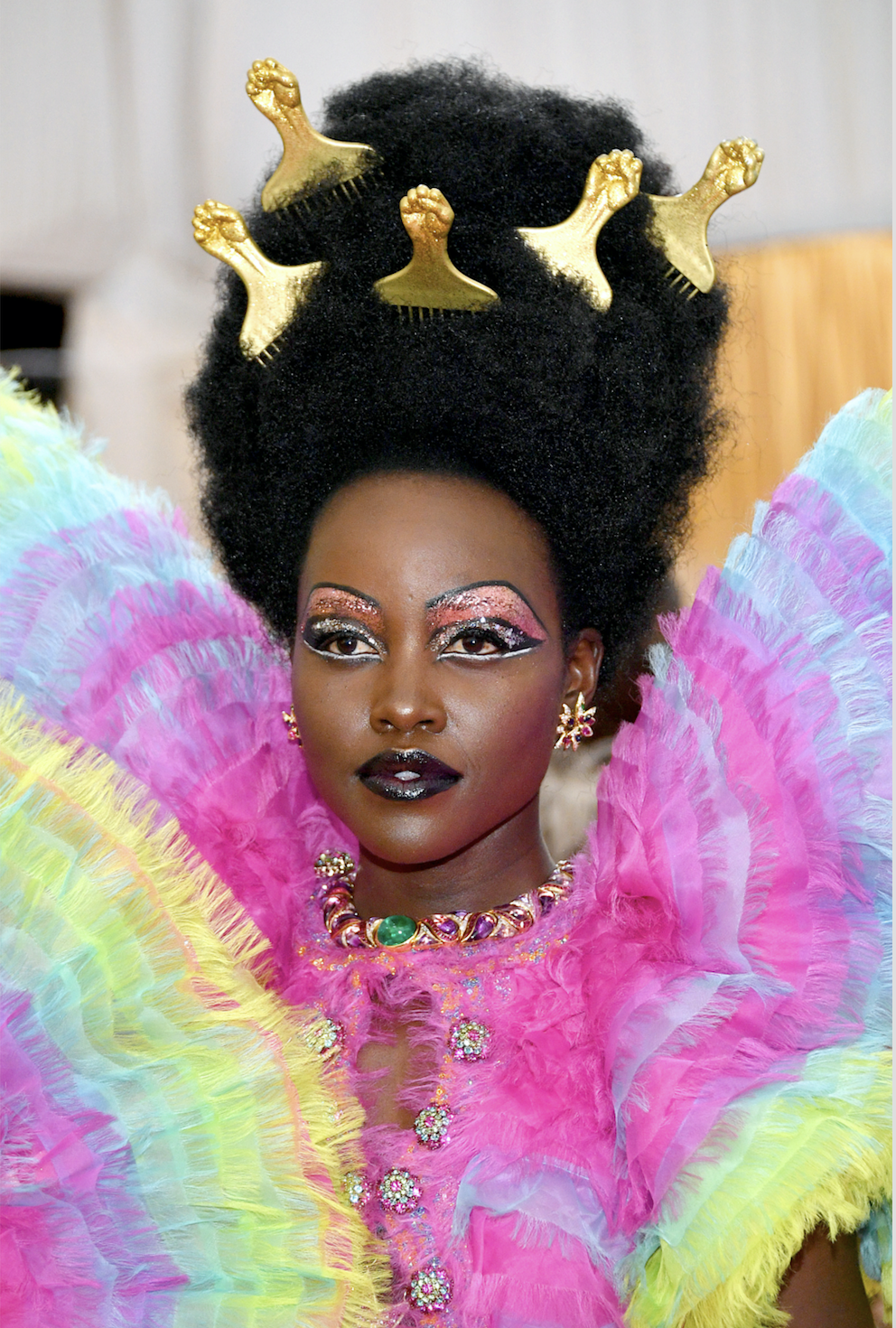 Lupita Nyong'o Leave it to Lupita to pay homage to the culture tonight with gold-painted hair picks in her afro perfected by the one and only Vernon François. I stan— forever.