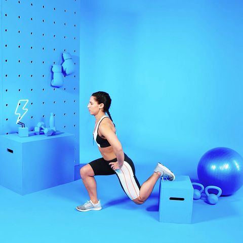 This is a photo of a female trainer demonstrating a Bulgarian split squat.