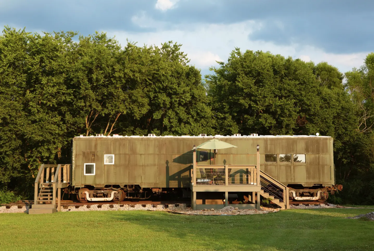 This Train Car From WWII Got An Insane Makeover to Become an Airbnb Rental