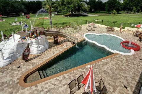 Swimming pool, Miniature golf, Leisure, Recreation, Backyard, Grass, Golf, Landscaping, Games,