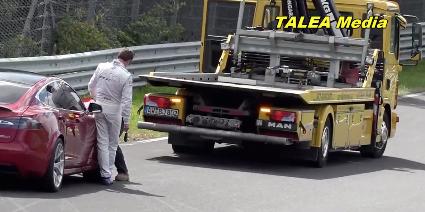 Watch 4 Porsches Lap a Tesla Model S Broken Down on the Nürburgring
