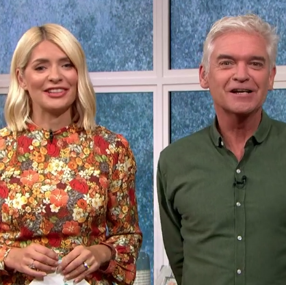 Today Holly Willoughby is autumn fashion goals in a stunning floral midi dress.