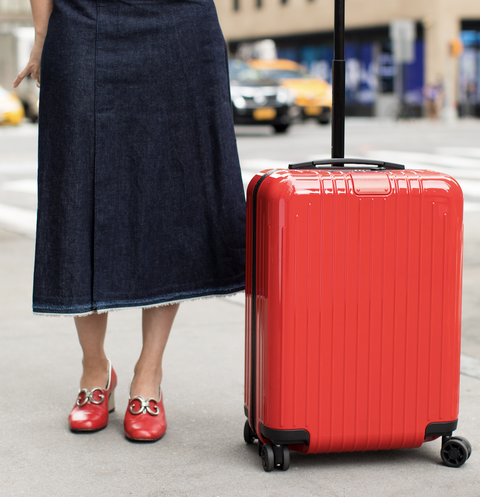 Suitcase, Clothing, Red, Waist, Hand luggage, Street fashion, Fashion, Travel, Leg, Baggage,