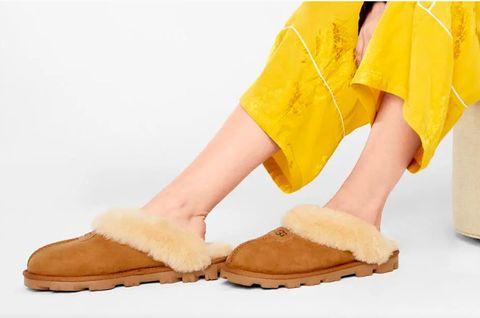 Footwear, Yellow, Shoe, Human leg, Leg, Ankle, Boot, Sandal, Foot, Fur,