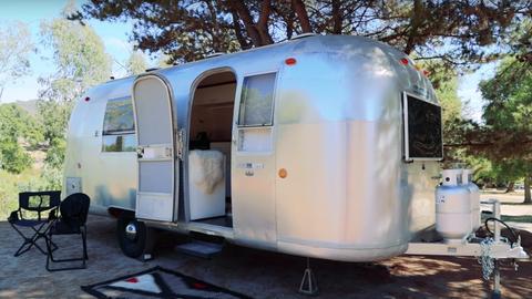 Travel trailer, Vehicle, Trailer, RV, Plant community, Caravan, Horse trailer, Car, Automotive exterior,
