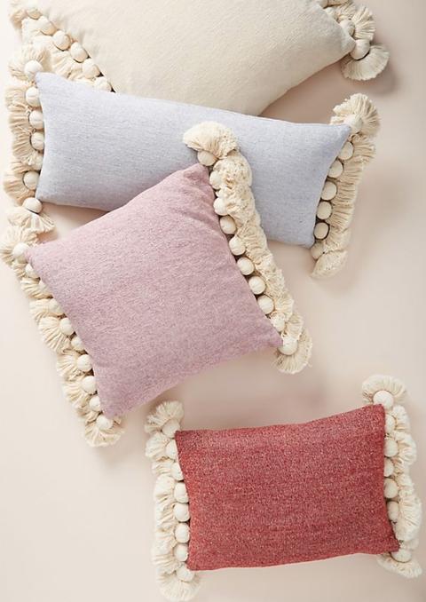 Pink, Pillow, Hand, Beige, Furniture, Cushion, Wool, Fashion accessory,