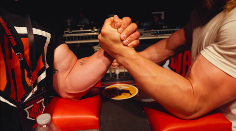 Arm wrestling, Wrestling, Arm, Leg, Muscle, Foot, Human body, Hand, Toe, Contact sport,