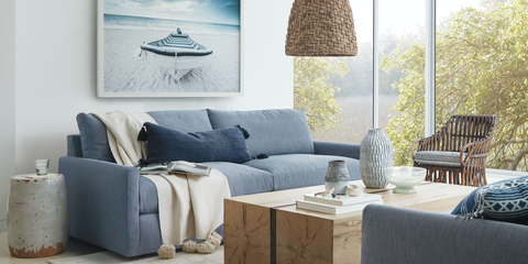 Furniture, Room, Blue, Living room, Wall, Interior design, studio couch, Table, Lighting, Couch,