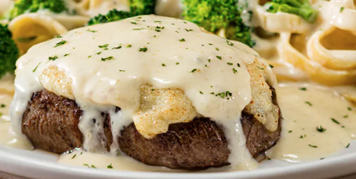 Olive Garden's New Parmesan-Alfredo Crusted Steak Is A Cheese Lover's Delight