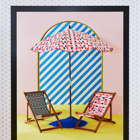 Anthropologie x Clare V. beach chairs and umbrella