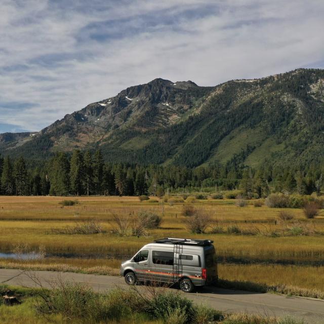 Highland, Mountainous landforms, Mountain, Sky, Hill, Wilderness, Grassland, Vehicle, Natural environment, Fell,