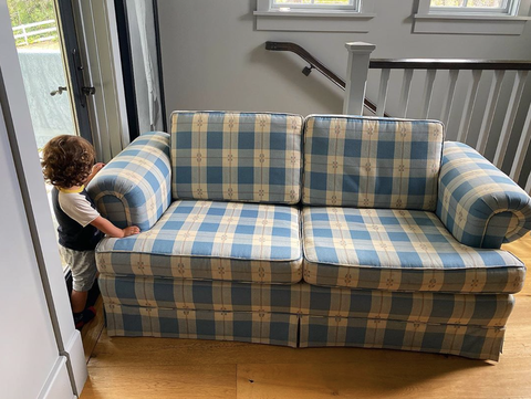 couch from Full House blocking a todler from the stairs