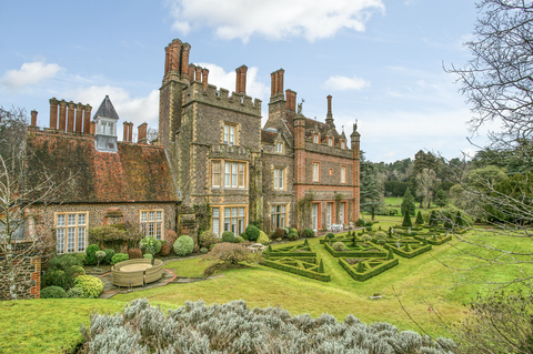 stone mansion with lush garden