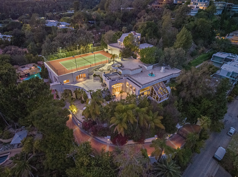 Los Angeles mansion with a tennis court and trees