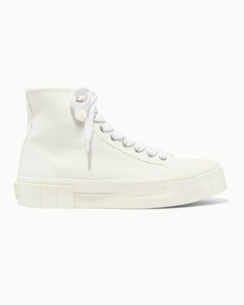 still life shot of white trainers from net a porter