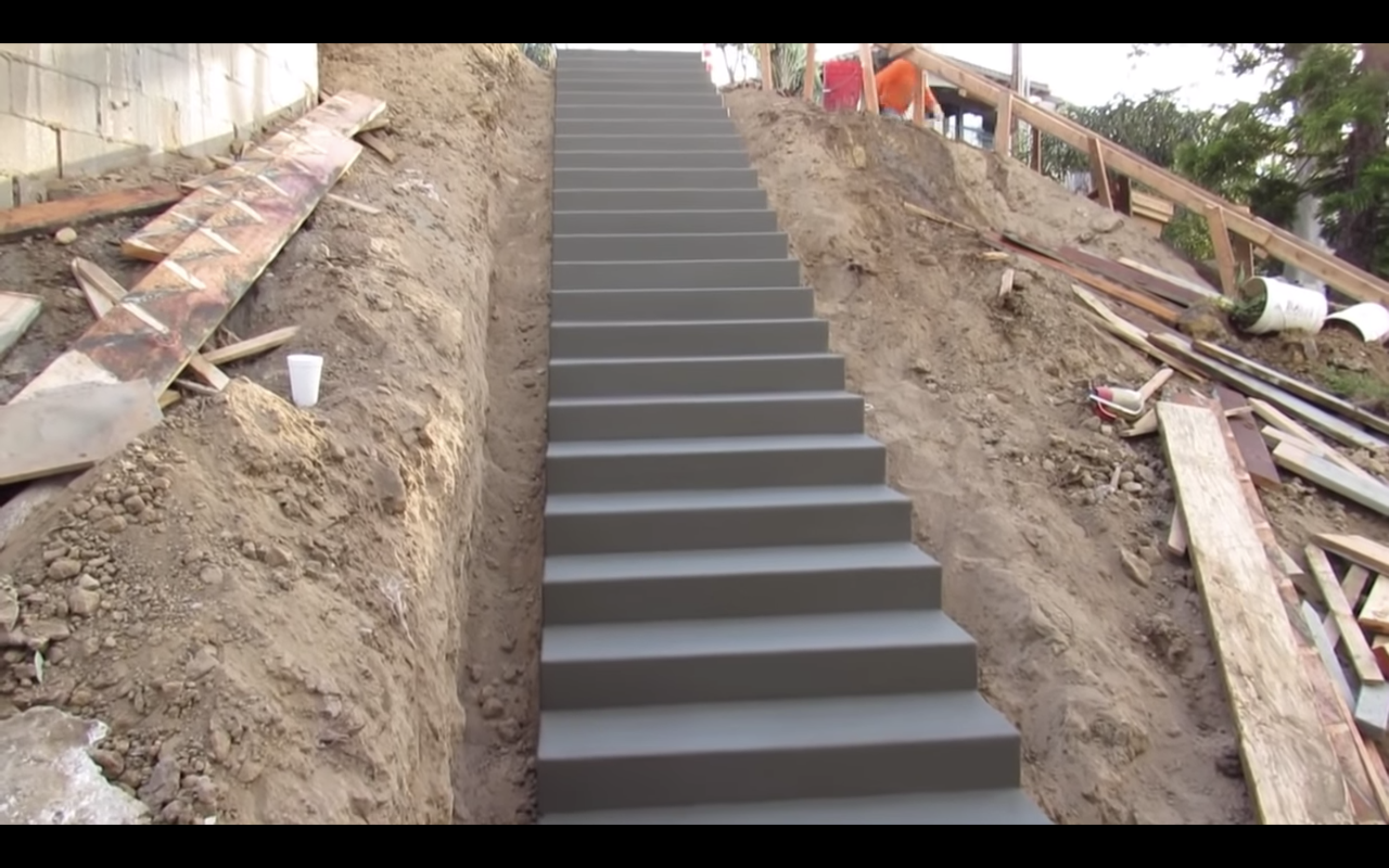 Watch Contractors Hypnotically Build a Perfect Concrete Stairway