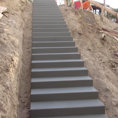 an image of a tall concrete staircase on the side of a hill