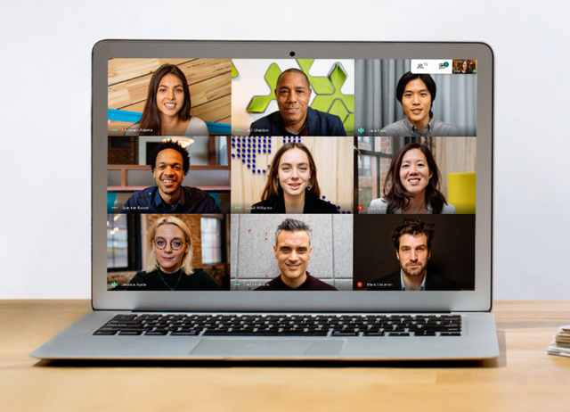a laptop screen showing a 3 by 3 grid of people video conferencing with google meet