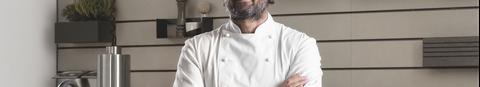 chef carlo cracco standing in his mia kitchen for scavolini