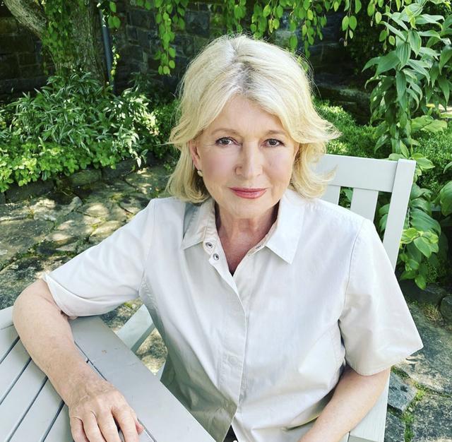 martha stewart sits in garden