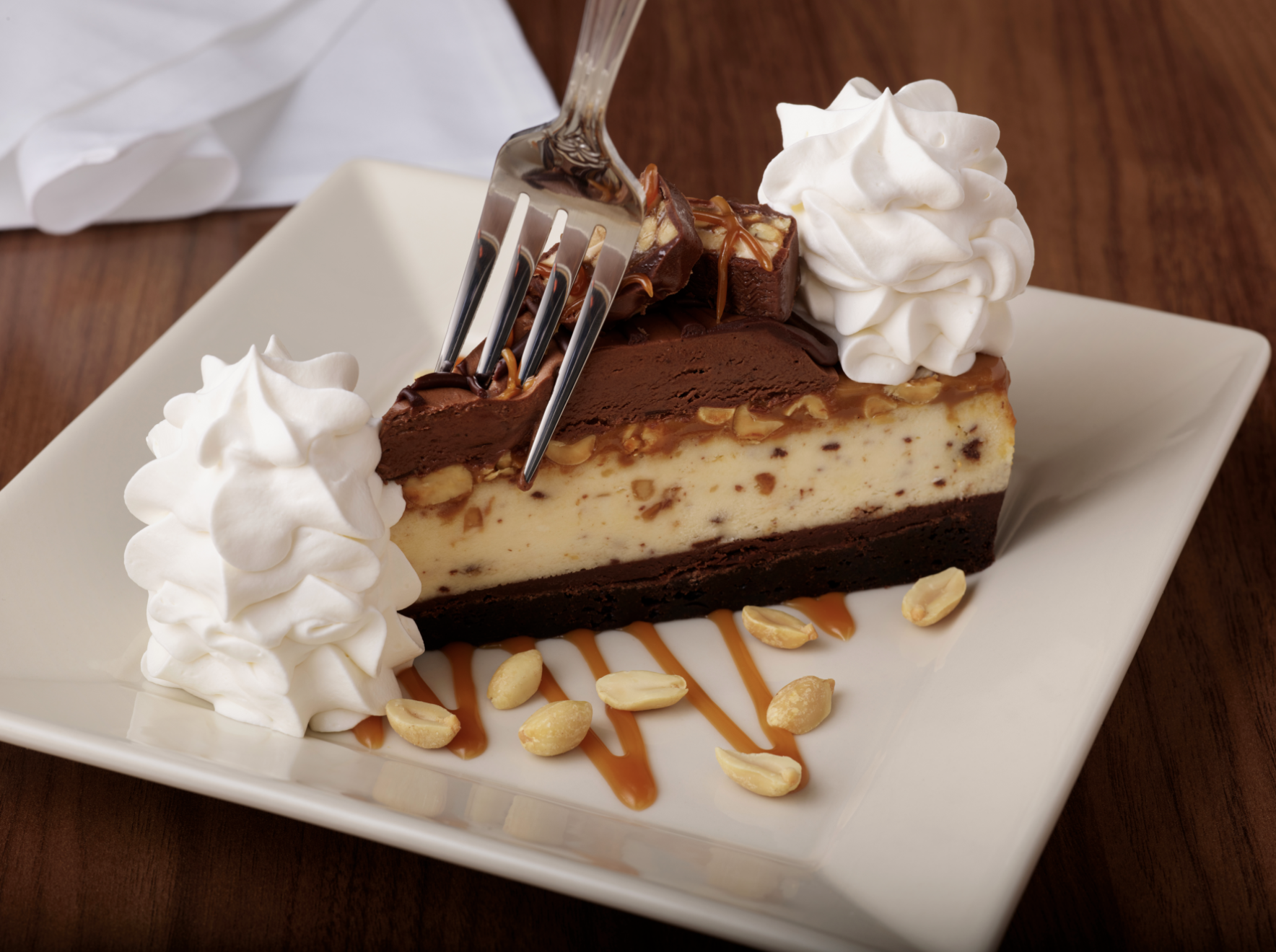 The Cheesecake Factory Is Introducing A New Snickers Cheesecake