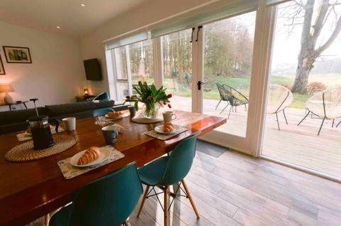 Wood, Interior design, Lighting, Room, Property, Floor, Table, Furniture, Home, Ceiling,