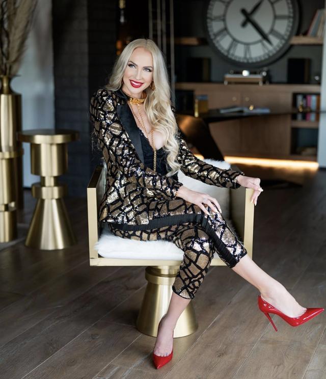 christine quinn poses in a chair