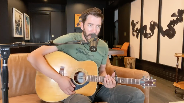 drew scott plays his guitar