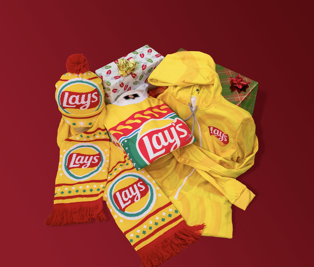 frito lay merch shop for the holidays, lay's hat, scarf, sweater, and onesie in bright yellow with red, green, and white design