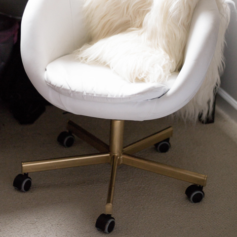 white ikea chair with gold bottom