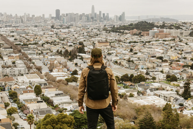 a man with a backpack on a hill