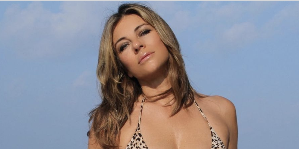Elizabeth Hurley Flaunts Super-Toned Abs While Wearing Her 'Favorite' Animal-Print Bikini