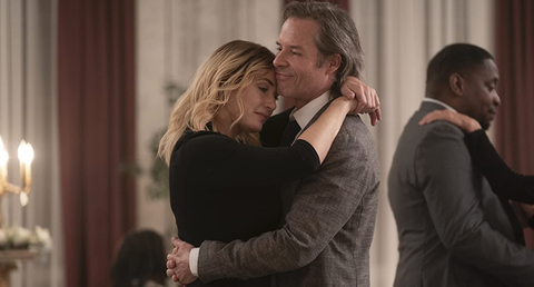kate winslet and guy pearce, two white actors, dance together in a still photo from mare of easttown
