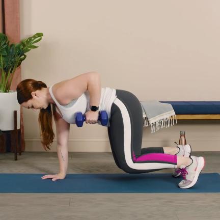 woman doing dumbbell exercise
