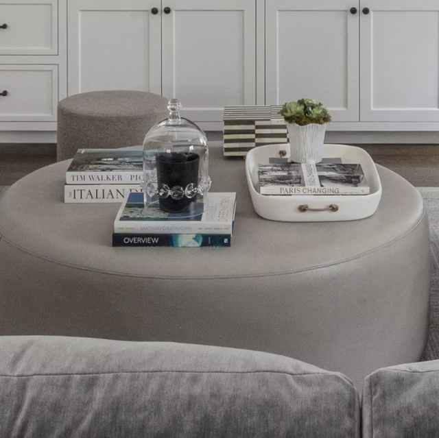 gray sitting room with candle on coffee table