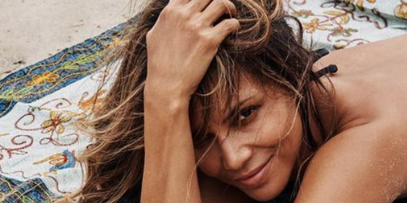 Halle Berry, 54, Shows Off Her Toned Abs and Legs Lounging on the Beach In a Bikini on Instagram