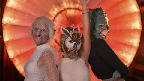 cast of netflix show sexy beasts including people in an old woman mask an owl mask and a dinosaur bird mask
