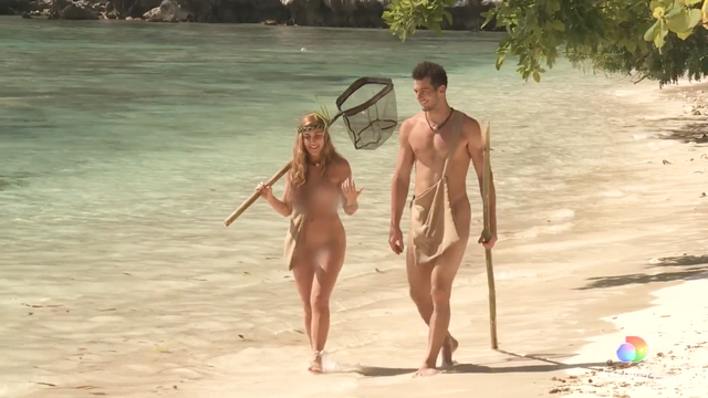 two contestants from the show naked and afraid of love walk together on a beach without clothing on