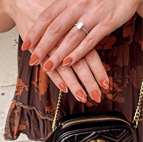 burnt orange nails with subtle beige accents
