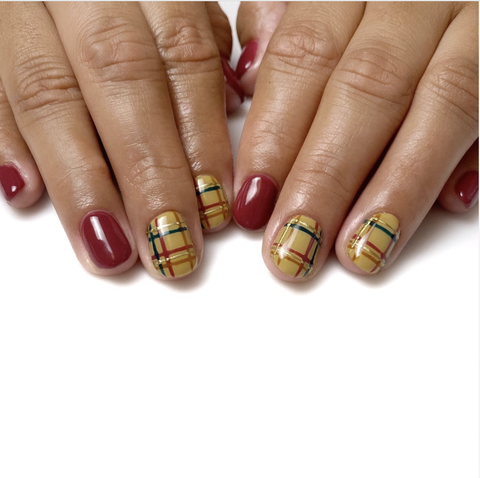 yellow and red plaid nails