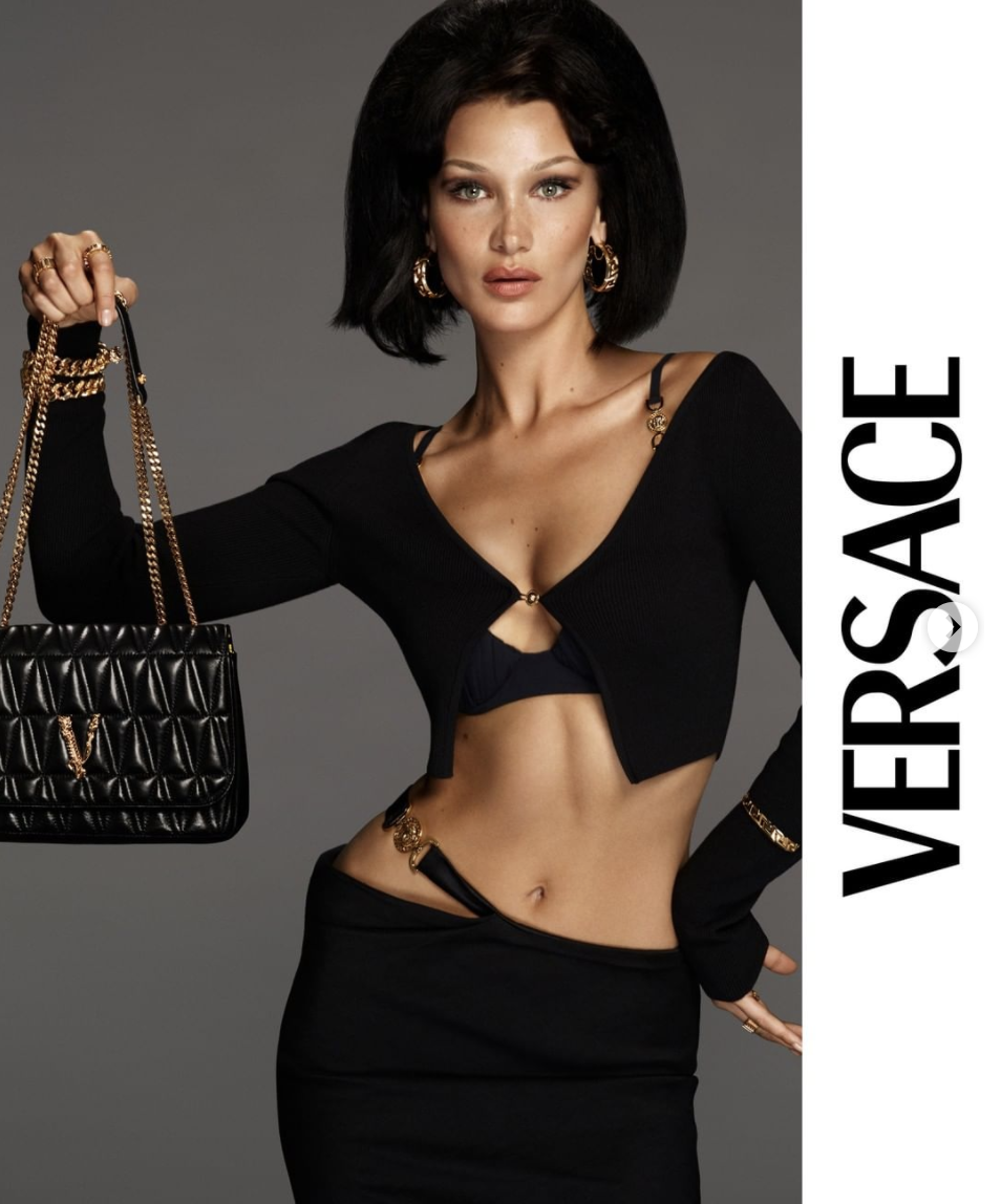 See Bella Hadid S Revealing Black Cardigan In A Versace Campaign