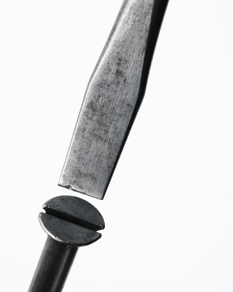 Screwdriver and screw, close-up